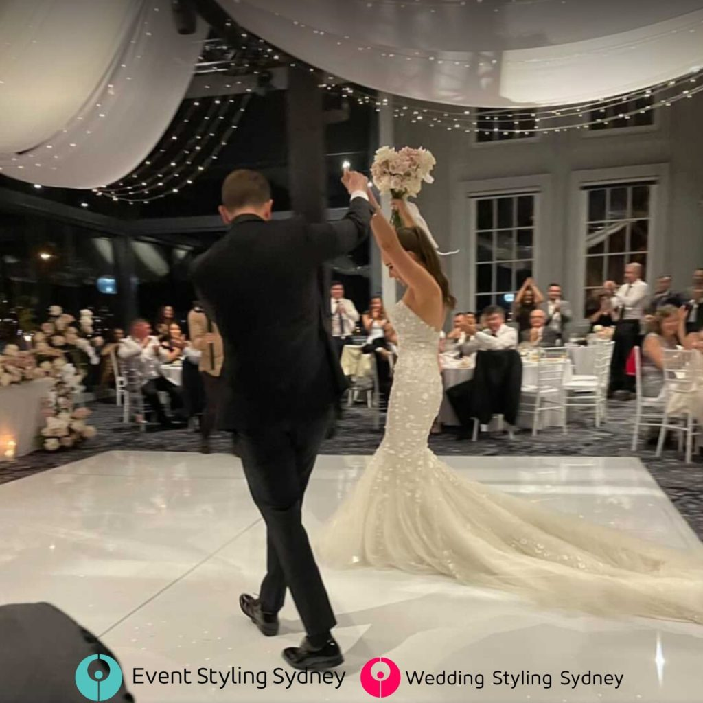 pier-one-water-wedding-ceiling-drapes-first-dance