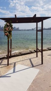 dark-timber-arbour-sydney-harbour-with-white-carpet-florals-min